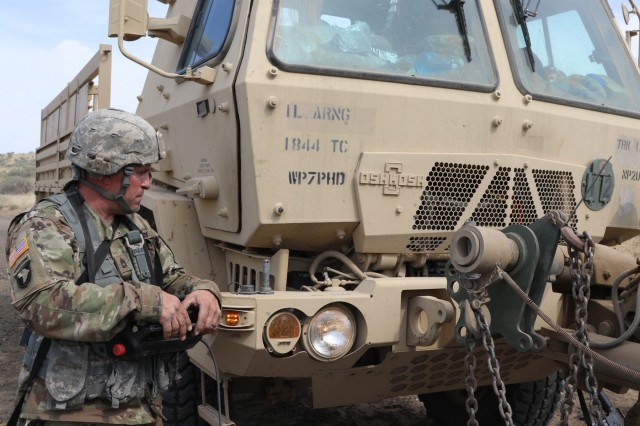 Maintenance Soldiers from the 1844th Transportation Company, 108th Sustainment Brigade work on attaching the recovery vehicle's towbar to a downed truck. Rising Thunder 2019 is an annual exercise joining the U.S. Army and the Japanese Ground Self-Defense Force (JGSDF) and is part of Pacific Pathways 19-3. Rising Thunder 2019 is also a United States Army Pacific-sponsored capstone event featuring U.S. Army units from the 7th Infantry Division and the Illinois Army National Guard's 33rd Infantry Brigade Combat Team and 108th Sustainment Brigade. (Illinois Army National Guard photo by Spc. Shaylin Quaid)