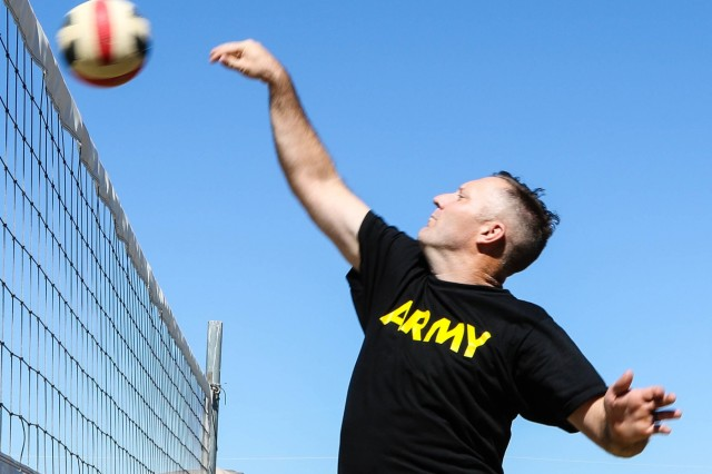 YAKIMA, Wash. - Sgt. David Williams from Headquarters Company, 2nd Battalion, 130th Infantry Regiment, 33rd Infantry Brigade Combat Team, Illinois Army National Guard scores with a tipped ball during a  close volleyball set against the Japan Ground Self-Defense Force on sports day at Rising Thunder 19 at Yakima Training Center, Washington, Sep. 4, 2019 . Rising Thunder 2019 is an annual exercise between the U.S. Army and the Japan Ground Self-Defense Force featuring units from the 7th Infantry Division, the Illinois Army National Guard's 33rd Infantry Brigade Combat Team and 108th Sustainment Brigade, and Japan's 25th Infantry Regiment. The exercise, held Aug. 28 - Sept. 13 at Yakima Training Center in Yakima, Washington, consists of company/platoon unilateral and bilateral training events in two phases, culminating with a bilateral live fire exercise. (U.S. Army Reserve photo by Sgt. James Barrington)