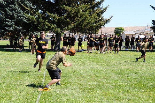 Soldiers from the Japan Ground Self-Defense Force throw-out a Soldier from the Illinois Army National Guard on sports day at Rising Thunder 19 at Yakima Training Center, Washington, Sep. 4, 2019 . Rising Thunder 2019 is an annual exercise between the U.S. Army and the Japan Ground Self-Defense Force featuring units from the 7th Infantry Division, the Illinois Army National Guard's 33rd Infantry Brigade Combat Team and 108th Sustainment Brigade, and Japan's 25th Infantry Regiment. The exercise, held Aug. 28 - Sept. 13 at Yakima Training Center in Yakima, Washington, consists of company/platoon unilateral and bilateral training events in two phases, culminating with a bilateral live fire exercise. (U.S. Army Reserve photo by Sgt. James Barrington)