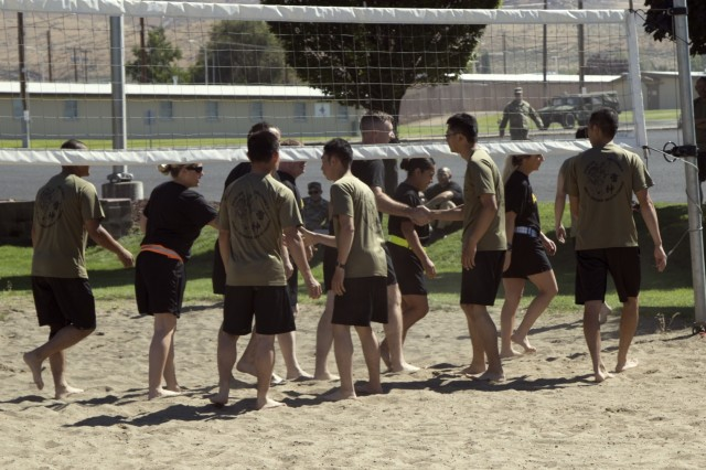 YAKIMA, Wash. - American and Japanese soldiers congratulate each other after a friendly game of volleyball during Rising Thunder 19. Rising Thunder 2019 is an annual exercise between the U.S. Army and the Japan Ground Self-Defense Force featuring units from the 7th Infantry Division, the Illinois Army National Guard's 33rd Infantry Brigade Combat Team and 108th Sustainment Brigade, and Japan's 25th Infantry Regiment. The exercise, held Aug. 28 - Sept. 13 at Yakima Training Center in Yakima, Washington, consists of company/platoon unilateral and bilateral training events in two phases, culminating with a bilateral live fire exercise. (U.S. Army Reserve photo by Sgt. Jeff Daniel)