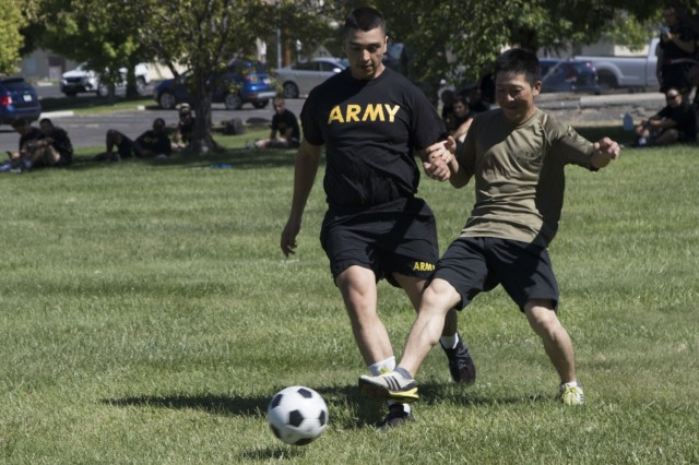 YAKIMA, Wash. - An American and Japanese soldier battle vie over the ball in a friendly game of soccer during Rising Thunder 19. Rising Thunder 2019 is an annual exercise between the U.S. Army and the Japan Ground Self-Defense Force featuring units from the 7th Infantry Division, the Illinois Army National Guard's 33rd Infantry Brigade Combat Team and 108th Sustainment Brigade, and Japan's 25th Infantry Regiment. The exercise, held Aug. 28 - Sept. 13 at Yakima Training Center in Yakima, Washington, consists of company/platoon unilateral and bilateral training events in two phases, culminating with a bilateral live fire exercise. (U.S. Army Reserve photo by Sgt. Jeff Daniel)