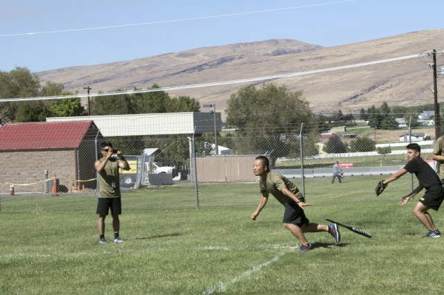 YAKIMA, Wash. - A Japanese soldier starts to run towards first base after the ball is hit on a recreational day during Rising Thunder 19. Rising Thunder 2019 is an annual exercise between the U.S. Army and the Japan Ground Self-Defense Force featuring units from the 7th Infantry Division, the Illinois Army National Guard's 33rd Infantry Brigade Combat Team and 108th Sustainment Brigade, and Japan's 25th Infantry Regiment. The exercise, held Aug. 28 - Sept. 13 at Yakima Training Center in Yakima, Washington, consists of company/platoon unilateral and bilateral training events in two phases, culminating with a bilateral live fire exercise. (U.S. Army Reserve photo by Sgt. Jeff Daniel)