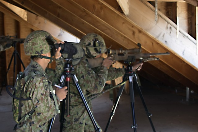 A sniper team from the 25th Infantry Regiment aims to fire while the sniper team from the 2-130th Infantry Regiment fires along side of them during Rising Thunder 19. Rising Thunder 2019 is an annual exercise between the U.S. Army and the Japan Ground Self-Defense Force featuring units from the 7th Infantry Division, the Illinois Army National Guard's 33rd Infantry Brigade Combat Team and 108th Sustainment Brigade, and Japan's 25th Infantry Regiment. The exercise, held Aug. 28 through Sept. 13 at Yakima Training Center in Yakima, Wash., consists of company/platoon unilateral and bilateral training events in two phases, culminating with a bilateral live fire exercise.