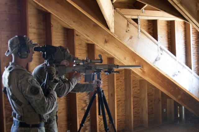 A sniper team from the 2-130th sniper team aims to fire during Rising Thunder 19. Rising Thunder 2019 is an annual exercise between the U.S. Army and the Japan Ground Self-Defense Force featuring units from the 7th Infantry Division, the Illinois Army National Guard's 33rd Infantry Brigade Combat Team and 108th Sustainment Brigade, and Japan's 25th Infantry Regiment.