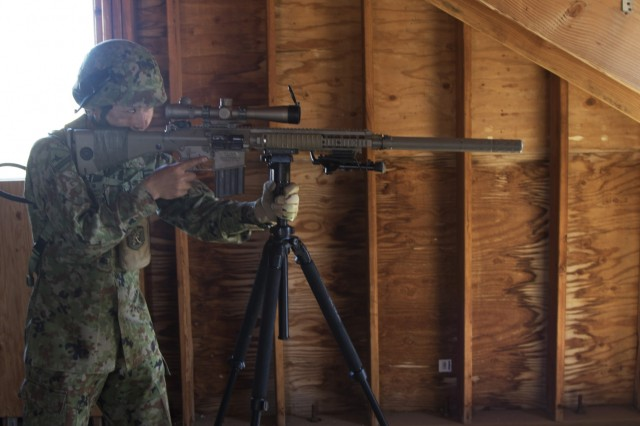 A member of the 25th Infantry Regiment uses a U.S weapon system to fire a shot in the direction of a makeshift village during Rising Thunder 19. Rising Thunder 2019 is an annual exercise between the U.S. Army and the Japan Ground Self-Defense Force featuring units from the 7th Infantry Division, the Illinois Army National Guard's 33rd Infantry Brigade Combat Team and 108th Sustainment Brigade, and Japan's 25th Infantry Regiment.