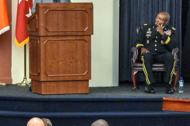"Retired Maj. Dennis ""DJ"" Skelton discusses why he chose to stay in the Army after suffering grievous wounds during Operation Iraqi Freedom in 2004, during a ""Why We Serve"" ceremony at Fort Belvoir, Va., Sept. 5, 2019. At the start of the ceremony, Lt. Gen. Bruce T. Crawford, Army chief information officer G-6, discussed the Army's role in taking care of people and emphasized the importance of service to the nation."