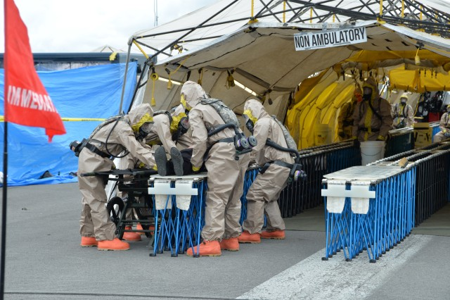 New York Army National Guard Soldiers of the Homeland Response Force for FEMA Region 2 prepare a litter casualty for movement to decontamination during chemical, biological, radiological or nuclear (CBRN) incident response training at the New York State Preparedness Training Center in Oriskany, N.Y. September 7, 2019. Decontamination team members are assigned to the 642nd Support Battalion and cross-trained for the CBRN response skills needed for decontamination. More than 600 Soldiers and Airmen of the New York and New Jersey National Guard participated in the training to prepare for the task force capabilities to conduct casualty evacuation, decontamination and medical triage under CBRN conditions.