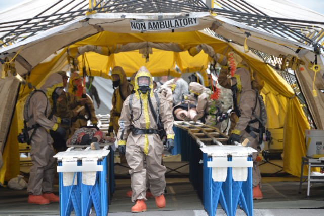 New York Army National Guard Soldiers of the Homeland Response Force for FEMA Region 2 provide decontamination for simulated victims during chemical, biological, radiological or nuclear (CBRN) incident response training at the New York State Preparedness Training Center in Oriskany, N.Y. September 7, 2019. Decontamination team members are assigned to the 642nd Support Battalion and cross-trained for the CBRN response skills needed for decontamination. More than 600 Soldiers and Airmen of the New York and New Jersey National Guard participated in the training to prepare for the task force capabilities to conduct casualty evacuation, decontamination and medical triage under CBRN conditions.