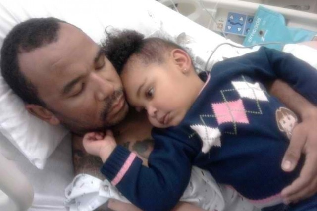 Then Staff Sgt. Nino Gray gets a visit from his niece Kali while recovering at Walter Reed Army Medical Center. September 2010. (Photo courtesy Nino Gray)