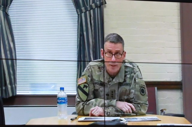 """FORT BENNING, Ga. - Lt. Gen. Gary Volesky, commander of I Corps, headquartered at Joint Base Lewis-McChord, talks via video teleconference to an auditorium of Army leaders Sept. 10 here at McGinnis-Wickam Hall. The Maneuver Warfighter Conference is an annual event hosted by the Maneuver Center of Excellence that gathers senior leaders and subject matter experts from across the Army, sister services and from partner nations' militaries to elaborate upon and discuss issues relevant to the Army's Maneuver Force. The theme of this year's conference is """"The Brigade Combat Team: Readying for Large Scale Combat."""" (U.S. Army photo Markeith Horace, Maneuver Center of Excellence and Fort Benning Public Affairs Office)"""