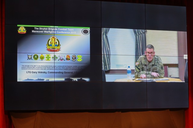 """FORT BENNING, Ga. - Lt. Gen. Gary Volesky, commander of I Corps, headquartered at Joint Base Lewis-McChord, talks via video teleconference to an auditorium of Army leaders Sept. 10 here at McGinnis-Wickam Hall. The Maneuver Warfighter Conference is an annual event hosted by the Maneuver Center of Excellence that gathers senior leaders and subject matter experts from across the Army, sister services and from partner nations' militaries to elaborate upon and discuss issues relevant to the Army's Maneuver Force. The theme of this year's conference is """"The Brigade Combat Team: Readying for Large Scale Combat."""" (U.S. Army photo Markeith Horace, Maneuver Center of Excellence, Fort Benning Public Affairs Office)"""