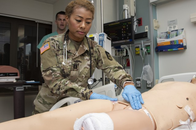 U.S. Army Capt. Mary Truitt, an internist from Eisenhower Army Medical Center, Fort Gordon, Ga., performs a survey on a simulated trauma patient at Brooke Army Medical Center, Fort Sam Houston, Texas, Sep. 4, 2019. Military doctors from around the country attended training at BAMC for validation training for the Army's Individual Common Task List and the Air Force Comprehensive Medical Readiness Program requirements.