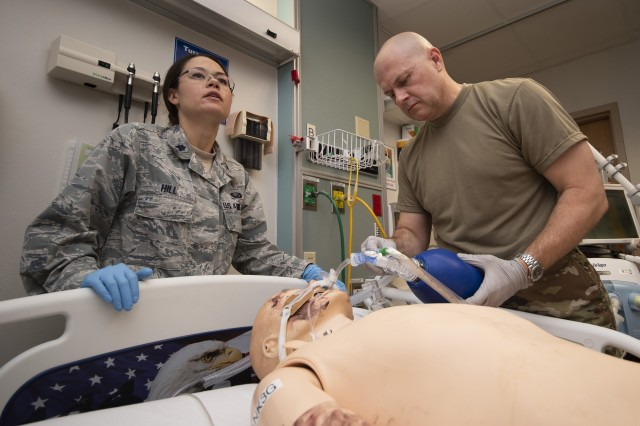 U.S. Air Force Lt. Col. Erica Hill, Brooke Army Medical Center rheumatologist, and U.S. Army Col. Ramey Wilson, Command Surgeon, Special Operations Command, Africa, assess a simulated trauma patient at BAMC, Fort Sam Houston, Texas, Sep. 4, 2019. Military doctors from around the country attended training at BAMC for validation training for the Army's Individual Common Task List and the Air Force Comprehensive Medical Readiness Program requirements.