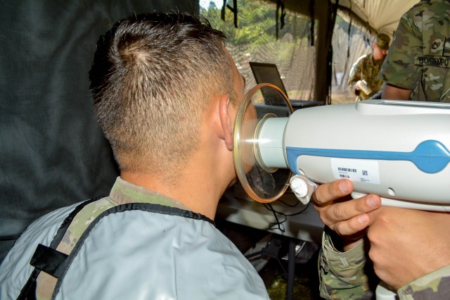 "A U.S. Army Soldier from the 16th Sustainment Brigade receives an X-ray Sept. 4 from Soldiers from Dental Health Command Europe during ""Operation Tombstone.""  ""Operation Tombstone"" was a field training exercise conducted by Dental Health Command Europe in conjunction with the 16th Sustainment Brigade."