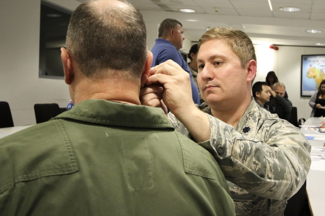 U.S. Air Force Lt. Col. James Cox, chief of medical staff and internal medicine physician, 31st Medical Group, Aviano Air Base, Italy, practices acupuncture as a form of pain management during Landstuhl Regional Medical Center's Traumatic Brain Injury and Rehabilitation Clinic's TBI Champion Training Conference, at Ramstein Air Base, Germany, Sept. 6. The three-day conference assembled medical professionals across Europe and Western Asia to promote standardization of TBI clinical care by sharing knowledge, current recommendations and best practices.