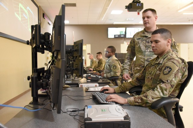 Soldiers from 53rd Signal Battalion perform duties on the operation floor inside the Wideband Satellite Communications Operations Center in Fort Meade, Md. In May, the Army Space and Missile Defense Command stood up Task Force Eagle to consolidate its SATCOM missions, including the signal battalion, ahead of U.S. Space Command's activation last month.