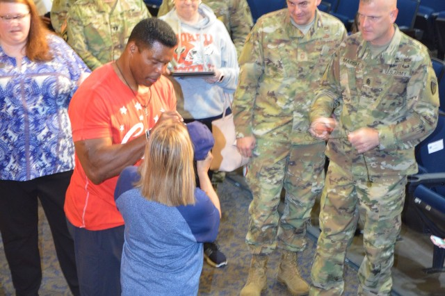 A group of people lined the walls of Carey Theater on Joint Base Lewis-McChord to meet with Hershel Walker after he spoke Sept. 10.