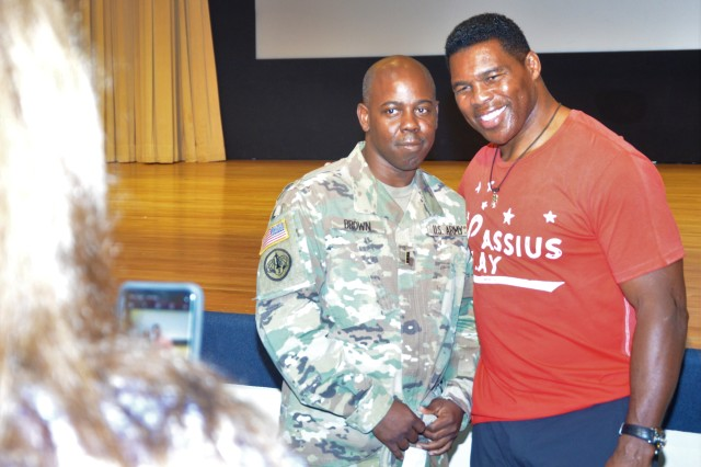 Herschel Walker, left, poses with Chief Warrant Officer 4 Richard Brown, 1st Battalion, 357th Infantry Regiment, 189th Combined Arms Training Brigade, at Carey Theater on Joint Base Lewis-McChord Sept. 10.