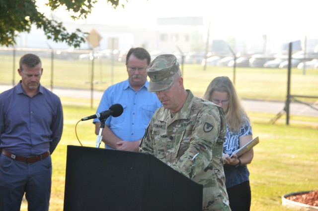 TACOM Command Chaplain Scott Koeman pauses for a moment of silence during the Patriot Day Observance.