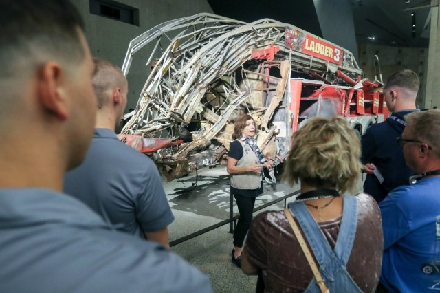 9/11 Museum tour guide talks to visitors including U.S. Military Academy Preparatory School Cadet Candidates about the firefighters from Ladder 3 who died after responding the the Twin Towers on Sept. 11 2001 Tuesday during the school's annual visit to the 9/11 museum and memorial  to mark the anniversary of the terrorist attacks. (U.S. Army photo by Brandon O'Connor)