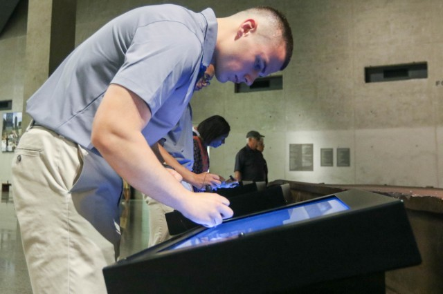 U.S. Military Academy Preparatory School Cadet Candidate Cameron Dyke signs a memorial Tuesday during the school's annual visit to the 9/11 museum and memorial  to mark the anniversary of the terrorist attacks. (U.S. Army photo by Brandon O'Connor)
