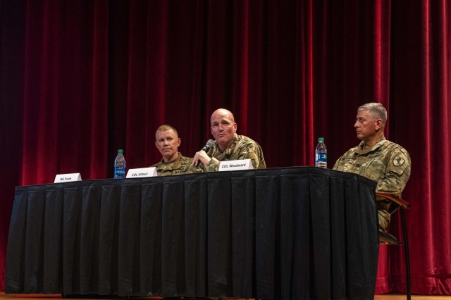 FORT BENNING, Ga. - From left, Brig. Gen. Patrick D. Frank, commanding general of the Joint Readiness Training Center and Fort Polk; Col. Joseph E. Hilbert, commander of the Joint Multinational Readiness Center at Hohenfels, Germany; and Col. Scott Woodward, commander of the 11th Armored Cavalry Regiment at the National Training Center at Fort Irwin, California, form a panel of military experts discussing trends related to the U.S. Army's Combat Training Centers Sept. 11 here during the 2019 Maneuver Warfighter Conference at McGinnis-Wickam Hall. Hosted the Maneuver Center of Excellence, the conference runs Sept. 10-12 and brings together key military professionals to explore issues, ideas and trends related to the Army's maneuver force. Combat Training Centers provide fighting units with rigorous training that mimics the circumstances of actual combat. (U.S. Army photo by Patrick Albright, Maneuver Center of Excellence, Fort Benning Public Affairs)
