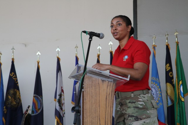 U.S. Army Sgt. 1st Class Angela Curry, religious affairs noncommissioned officer in charge, Area Support Group-Kuwait, was the guest speaker for the Patriot Day commemoration ceremony Sept. 11, 2019, at Camp Arifjan, Kuwait. During her speech, Curry highlighted the feeling of unity the United States felt in the days, weeks, months and years following the attacks that left nearly 3,000 people dead. (U.S. Army Reserve photo by Sgt. Zach Mott)
