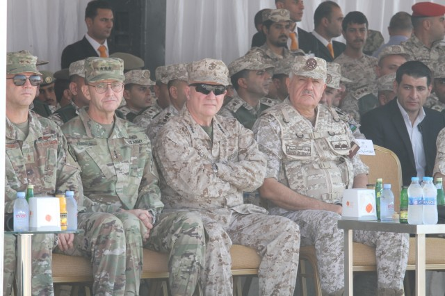 Seated from left, U.S. Air Force Maj. Gen. Bradley Swanson, director of exercises, U.S. Central Command; U.S. Army Lt. Gen. Terry Ferrell, commanding general, U.S. Army Central Command; U.S. Marine Corps Gen. Kenneth F. McKenzie Jr., commander, U.S. Central Command, and Jordan Armed Forces Maj. Gen. Yousef Huneiti, chairman, Joint Chiefs of Staff; watch the culminating event of exercise Eager Lion 2019 in the Jordanian desert Sept. 5, 2019.  This multinational exercise is U.S. Central Command's premiere exercise in the Levant region and is a major training event that provides U.S. forces, Jordan Armed Forces and 28 other participating nations the opportunity to improve their collective ability to plan and operate in a coalition-type environment. (U.S. Army Reserve photo by Sgt. Zach Mott)