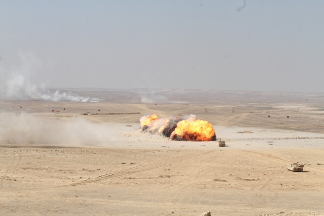 The brightly colored explosion of an M58 Mine Clearing Line Charge was a highlight of the culminating live-fire demonstration featuring the armed forces of Jordan, United States, Qatar, Saudi Arabia and United Kingdom during Eager Lion 2019 in Jordan, Sept. 5, 2019. This multinational exercise is U.S. Central Command's premiere exercise in the Levant region and is a major training event that provides U.S. forces, Jordan Armed Forces and 28 other participating nations the opportunity to improve their collective ability to plan and operate in a coalition-type environment. (U.S. Army Reserve photo by Sgt. Zach Mott)