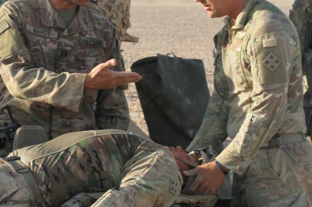 U.S. Army Capt. Bryan Marot, left, a physician's assistant with Headquarters and Headquarters Company, 1st Battalion, 68th Armor Regiment, 3rd Armored Brigade Combat Team, 4th Infantry Division, Task Force Spartan, and Pvt. Zachary Risz, a medic also with HHC, assess a simulated casualty as part of medical evacuation training Aug. 24, 2019, in Jordan in preparation for Exercise Eager Lion 19. This multinational exercise is U.S. Central Command's premiere exercise in the Levant region and is a major training event that provides U.S. forces, Jordan Armed Forces and 28 other participating nations the opportunity to improve their collective ability to plan and operate in a coalition-type environment. (U.S. Army Reserve photo by Sgt. Zach Mott)