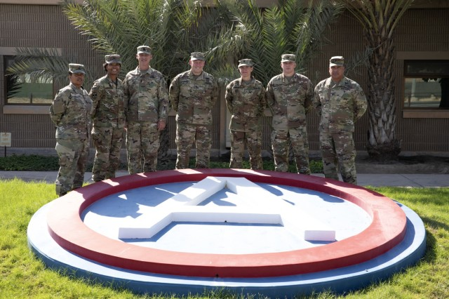 U.S. Army Reserve senior leaders pose for a photograph during a visit to Camp Arifjan, Kuwait, Sept. 10, 2019. The senior leaders were in the U.S. Army Central area of operations to visit with deployed soldiers and to receive updates on current operations. (U.S. Army Reserve photo by Sgt. Jennifer Shick)
