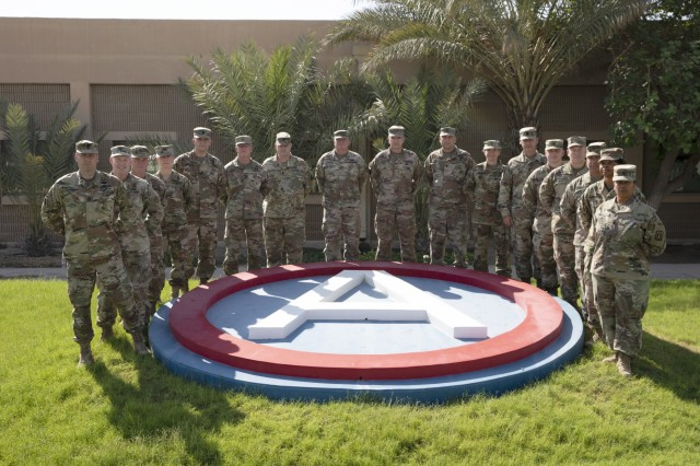 U.S. Army Reserve and National Guard senior leaders pose for a photograph during a visit to Camp Arifjan, Kuwait, Sept. 9, 2019. The senior leaders were in the U.S. Army Central area of operations to visit with deployed soldiers and to receive updates on current operations. (U.S. Army Reserve photo by Sgt. Jennifer Shick)