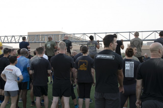 Service members with Combined Joint Task Force - Operation Inherent Resolve (CJTF-OIR) compete in the flexed arm hang event during a special morning physical training session celebrating the 75th anniversary of the XVIII Airborne Corps on Camp Arifjan, Kuwait, August 22, 2019. The XVIII Airborne Corps was born August 25, 1944 in Osbourne, St. George, England from the XVIII Corps during World War II, assuming command of the 82nd Airborne and 101st Airborne Divisions, as part of the preparation for Operation Market Garden. (U.S. Army Reserve photo by Sgt. Jennifer Shick)