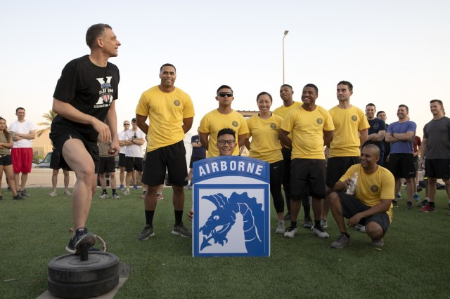 Command Sgt. Maj. Charles Albertson, senior enlisted leader, Combined Joint Task Force - Operation Inherent Resolve (CJTF-OIR), XVIII Airborne Corps, congratulates the winning team after a morning physical training competition celebrating the 75th anniversary of the XVIII Airborne Corps on Camp Arifjan, Kuwait, August 22, 2019. The XVIII Airborne Corps was born August 25, 1944 in Osbourne, St. George, England from the XVIII Corps during World War II, assuming command of the 82nd Airborne and 101st Airborne Divisions, as part of the preparation for Operation Market Garden. (U.S. Army Reserve photo by Sgt. Jennifer Shick)