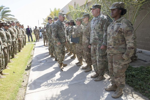 Soldiers with the Brigade Special Troops Battalion, 272nd Regional Support Group, Michigan Army National Guard stand at attention during an end-of-tour awards ceremony at Camp Arifjan, Kuwait, August 1, 2019. The Army's greatest asset is its people who are intelligent, adaptable and professional Soldiers.