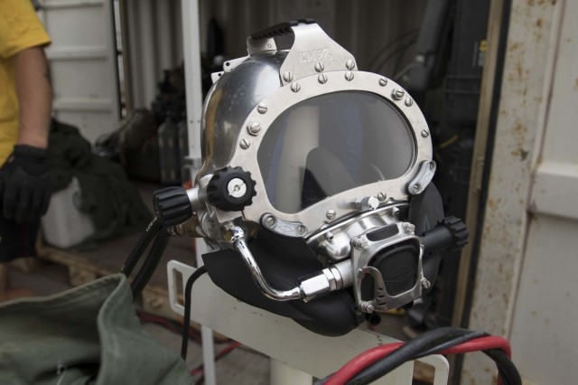 A diver's helmet is staged ready for the Soldier to wear while participating in the 511th Engineer Dive Detachment's annual training event 'shallow brown' at Kuwait Naval Base, Kuwait, July 19, 2019. The detachment is deployed to Kuwait in support of Operation Spartan Shield for U.S. Army Central. This training ensures the readiness of Soldiers within the ranks through equipment checks and qualifications. (U.S. Army Reserve photo by Sgt. Christopher Lindborg)