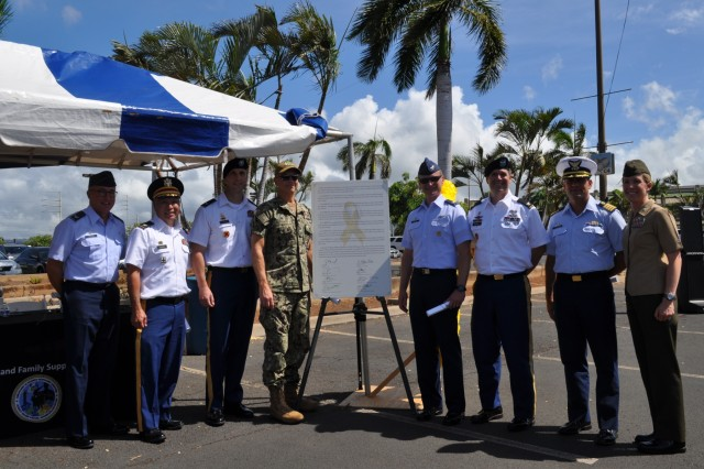 Honolulu, Hawaii - On World Suicide Prevention Day, leaders from across all branches of services came together to sign the 2019 Suicide Prevention Proclamation in support of suicide prevention and suicide awareness at the Navy Exchange in Honolulu, Hawaii. (Photo by Army Maj. Melodie Tafao)