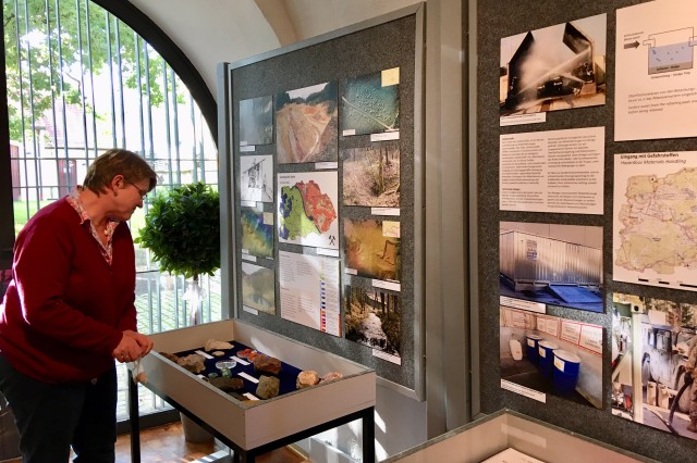 Caecilia Kastl-Meier, an environmental specialist for the U.S. Army Garrison Bavaria Environmental Division, sets up the Grafenwoehr Training Area Environmental Exhibit Sept. 11 at the Culture and Military Museum of Grafenwoehr. The exhibit opens Sept. 17 and runs through March 2020.