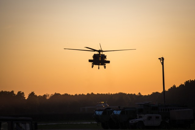 A U.S. Army UH-60 Blackhawk flies over Fort McCoy, Wis., during Combat Support Training Exercise (CSTX) 86-19-04 Aug. 19, 2019. CSTX 86-19-04 is a Combat Support Training Exercise that ensures America's Army Reserve units and Soldiers are trained and ready to deploy and bring capable, combat-ready and lethal firepower in support of the Army and our joint partners anywhere in the world. (U.S. Army Reserve photo by Spc. John Russell/86th Training Division)