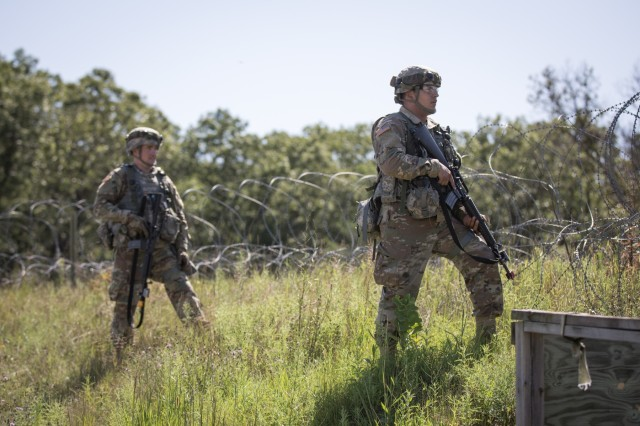U.S. Army Reserve Soldiers with the 865th Combat Support Hospital patrol a Tactical Assembly Area (TAA) during Combat Support Training Exercise (CSTX) 86-19-04 at Fort McCoy, Wis., Aug. 19, 2019. CSTX 86-19-04 is a Combat Support Training Exercise that ensures America's Army Reserve units and Soldiersare trained and ready to deploy and bring capable, combat-ready and lethal firepower in support of the Army and our joint partners anywhere in the world. (U.S. Army Reserve photo by Spc. John Russell/86th Training Division)