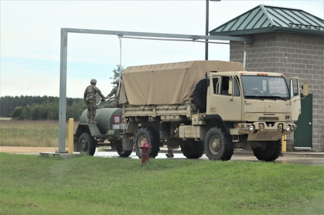 Service members at Fort McCoy, Wis., for training in the 86th Training Division's Combat Support Training Exercise (CSTX) 86-19-04 flush a water buffalo Aug. 20, 2019, at a water distribution point on South Post at the installation. The exercise included thousands of service members and coincided with other subordinate exercises taking place on post in August 2019, such as Global Medic and Patriot Warrior. (U.S. Army Photo by Scott T. Sturkol, Public Affairs Office, Fort McCoy, Wis.)