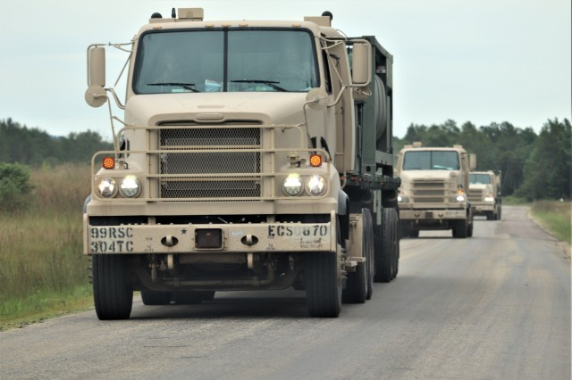 Service members at Fort McCoy, Wis., for training in the 86th Training Division's Combat Support Training Exercise (CSTX) 86-19-04 drive military vehicles in a convoy Aug. 20, 2019, on South Post at the installation. The exercise included thousands of service members and coincided with other subordinate exercises taking place on post in August 2019, such as Global Medic and Patriot Warrior. (U.S. Army Photo by Scott T. Sturkol, Public Affairs Office, Fort McCoy, Wis.)