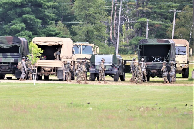 Service members at Fort McCoy, Wis., for training in the 86th Training Division's Combat Support Training Exercise (CSTX) 86-19-04 load into trucks Aug. 20, 2019, to participate in a training mission at the installation. The exercise included thousands of service members and coincided with other subordinate exercises taking place on post in August 2019, such as Global Medic and Patriot Warrior. (U.S. Army Photo by Scott T. Sturkol, Public Affairs Office, Fort McCoy, Wis.)