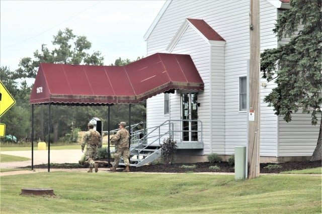 Service members at Fort McCoy, Wis., for training in the 86th Training Division's Combat Support Training Exercise (CSTX) 86-19-04 walk in the cantonment area Aug. 14, 2019 at the installation. The exercise included thousands of service members and coincided with other subordinate exercises taking place on post in August 2019, such as Global Medic and Patriot Warrior. (U.S. Army Photo by Scott T. Sturkol, Public Affairs Office, Fort McCoy, Wis.)