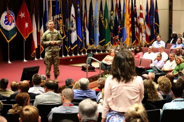 Maj. Gen. Todd Royar, AMCOM Command General, addresses employee concerns during the AMCOM town hall meeting, Sept. 9.