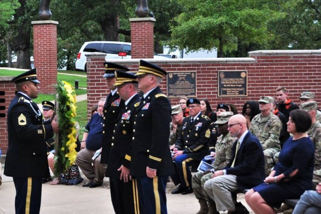 The U.S. Army Military Police School command group prepares to place a wreath at the 2018 Memorial Tribute at MP Memorial Grove. If MP Soldiers attend only one event this year, the MP School command sergeant major suggests the Memorial Tribute.