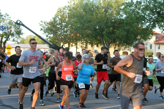 With a cannon shot, runners take off at the Marine Corps Artillery Detachment's 26th Annual Devil Dog Run held here Sept. 7, 2019, near the New Post Chapel.