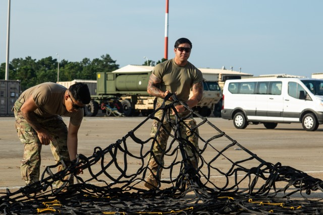 1st Security Force Assistance Brigade Advisors, conduct sling load assembly during the Advisor Forge training exercise at Fort Benning, GA, August 13, 2019.  Sling loads are delivered via aircraft to locations in need of supplies. (U.S. Army photo by Pfc. Daniel J. Alkana/ 22 Mobile Public Affairs Detachment.)