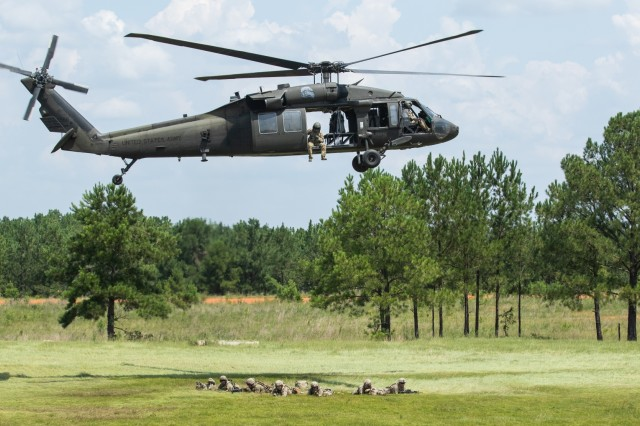 A team of Advisors with 1st Security Force Assistance Brigade, conduct perimeter security after  exiting a UH-60L Black Hawk during the Advisor Forge training exercise at Fort Benning, GA, August 13, 2019. The group of advisors were participating in certification training for worldwide employment. (U.S. Army photo by Pfc. Daniel J. Alkana/ 22 Mobile Public Affairs Detachment.)