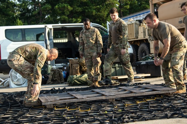 Advisors from 1st Security Force Assistance Brigade, conduct sling load assembly during the Advisor Forge training exercise at Fort Benning, GA, August 13, 2019.  Sling loads are delivered via aircraft to locations in need of supplies. (U.S. Army photo by Pfc. Daniel J. Alkana/ 22 Mobile Public Affairs Detachment.)
